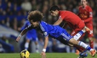 Chelsea's David Luiz, left, and Liverpool's Luis Suárez battle for the ball at Stamford Bridge