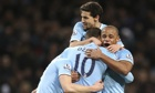 Manchester City's Edin Dzeko is congratulated by team-mates after scoring against Crystal Palace