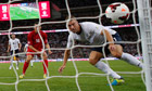 Rickie Lambert, right, heads home the ball for England in the World Cup qualifier against Moldova