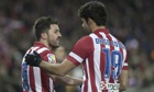 Atlético Madrid's David Villa, left, opened the scoring against Sevilla but the game ended at 1-1