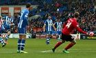 Wigan Athletic's Ben Watson, left, scores their second goal in the FA C
