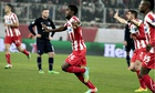 Joel Campbell, centre, celebrates scoring the second goal for Olympiakos against Manchester United