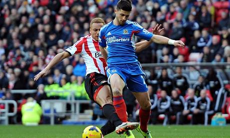 Sunderland's Wes Brown, left, fouls Hull City's Shane Long in the Premier League at Stadium of Light