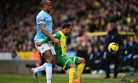 Norwich City's Nathan Redmond, right, and Vincent Kompany of Manchester City in the Premier League