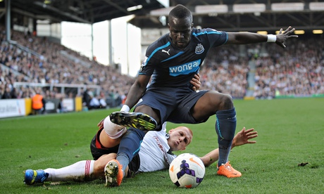 Fulham's Steve Sidwell tackles Cheick Tiote of Newcastle in the Premier League at Craven Cottage