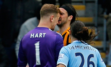 Manchester City's Joe Hart clashes with George Boyd of Hull City in the Premier League match