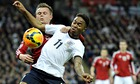 England's Raheem Sterling, right, vies for the ball with Peter Ankersen of Denmark at Wembley