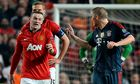 Bayern's Bastian Schweinsteiger fumes at Manchester United's Wayne Rooney after being sent off