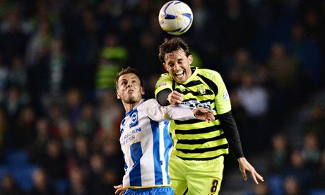 Brighton's Andrea Orlandi, left, and Yeovil's Rubén Palazuelos battle for the ball