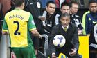 Chris Hughton, right, was hit by a paper clacker thrown by a Norwich fan in the game with West Brom