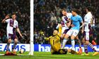 Manchester City's Edin Dzeko scores his second goal during the Premier League game with Aston Villa