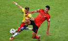 Neymar of Brazil and Mexico's Francisco Javier Rodríguez battle for the ball in the Group A match