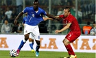 Italy's Mario Balotelli, left, battles for the ball with Tom Schnell of Luxembourg in Perugia.