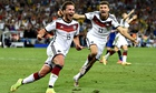 Germany's Mario Götze (left) celebrates with Thomas Muller after scoring the winning goal during ext