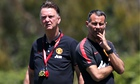 Louis van Gaal and assistant manager Ryan Giggs of Manchester United watch their team train in LA
