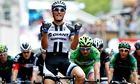 Marcel Kittel of Germany celebrates as he crosses the finish line to win the third stage