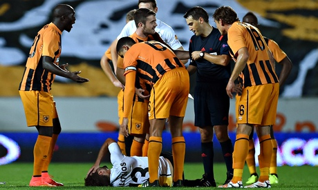 Hull City's Yannick Sagbo, left, shows his dismay after he is sent off against Lokeren