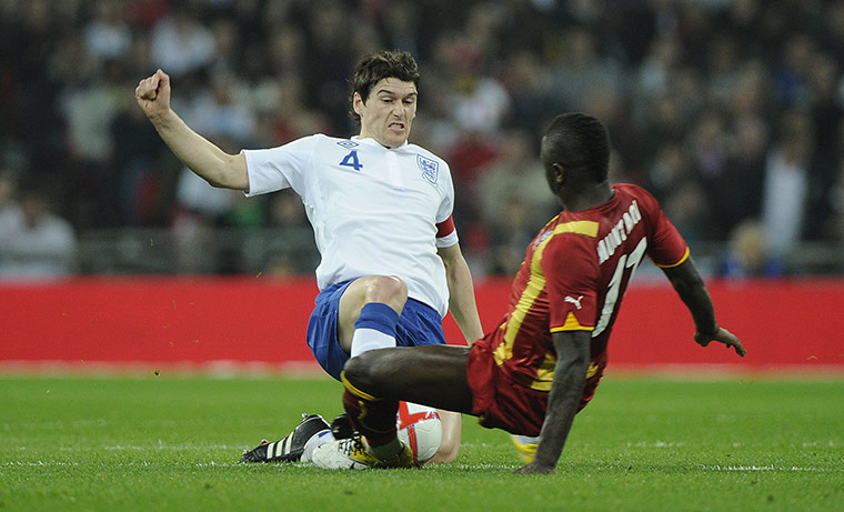 England v Ghana: Gareth Barry tackles Sulley Muntari