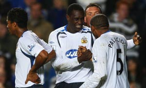 Wigan striker Emile Heskey celebrates with his teammates