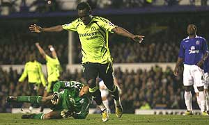 Michael Essien celebrates his goal against Everton