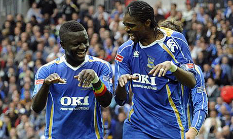Nwankwo Kanu and Sulley Muntari