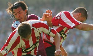 Carlos Tevez playing for West Ham against Sheffield United