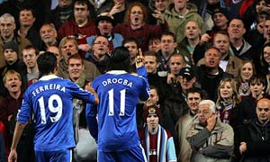 Chelsea forward Didier Drogba gestures towards Burnley fans