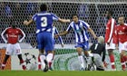 Bruno Alves scores for Porto against Arsenal.