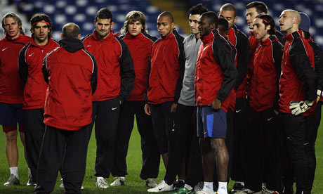 CFR Cluj manager Maurizio Trombetta speaks to his players during training at Stamford Bridge