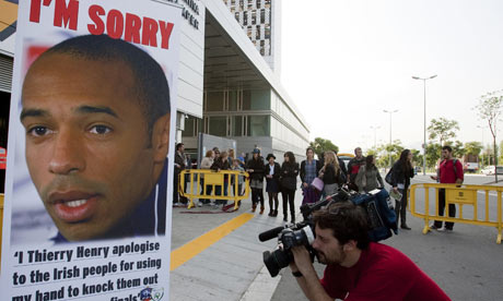 A banner calling for Thierry Henry to say sorry