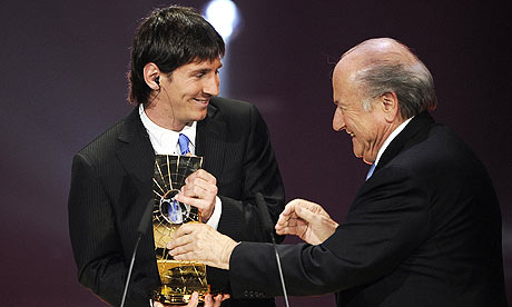 Lionel Messi accepts his World Player of the Year award from Fifa president Sepp Blatter