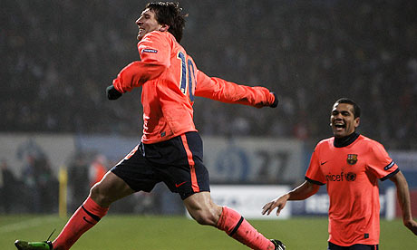 Barcelona's Lionel Messi celebrates after scoring the winning goal against Dynamo Kyiv
