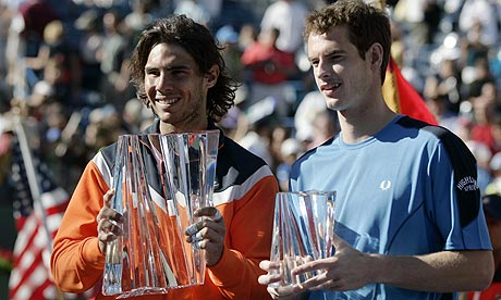 Nadal and Murray hold their trophies during the Indian Wells ATP final