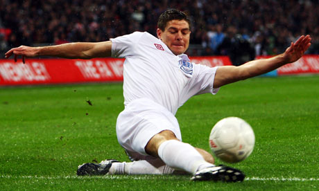 Steven Gerrard slides in to collect the ball at Wembley