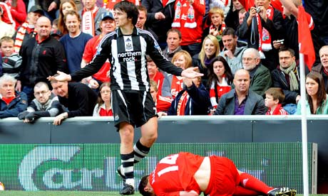 Joey Barton appeals to the referee as he is sent off for a foul on Liverpool's Xabi Alonso