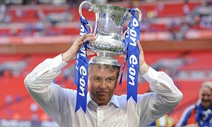 Chelsea manager Guus Hiddink with the FA Cup on his head