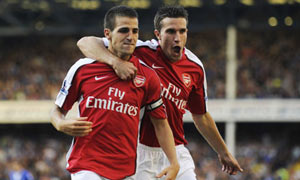 Cesc Fabregas and Robin van Persie celebrate Arsenal's fourth goal at Everton