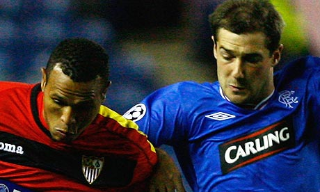 Kevin Thomson of Rangers tackles Luis Fabiano