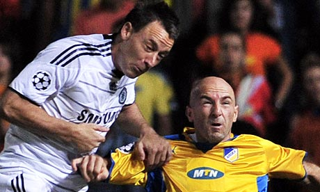 John Terry fights for the ball with Nenad Mirosavljevic