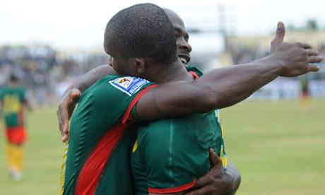 Samuel Eto'o, right, celebrates scoring for Cameroon against Gabon