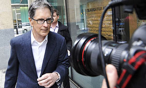 John W Henry arrives at Slaughter & May's offices in London