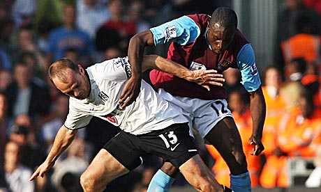 Fulham's Danny Murphy and West Ham's Carlton Cole tussle for the ball