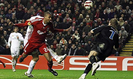 Liverpool's David Ngog heads the winner against Unirea Urziceni
