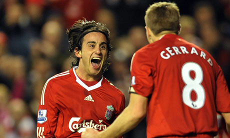 Alberto Aquilani celebrates scoring Liverpool's third goal against Portsmouth