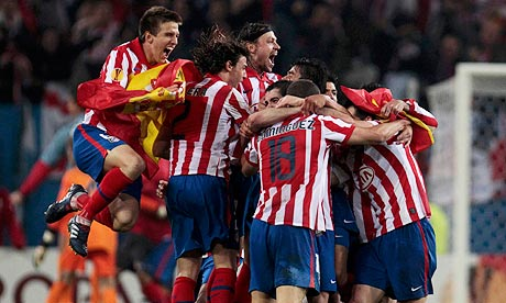 Atlético Madrid's players celebrate after beating Fulham in the Europa League final