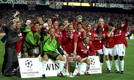 United players pose for pictures with the 1999 Champions League Trophy