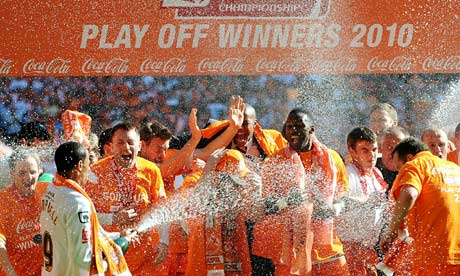 Blackpool's DJ Campbell (2nd L) sprays c