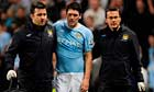 England's prospective World Cup 2010 midfielder Gareth Barry limps off for Manche