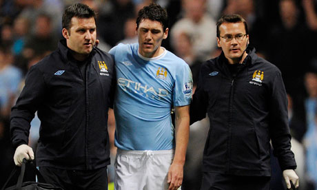 England's prospective World Cup 2010 midfielder Gareth Barry limps off for Manchester City
