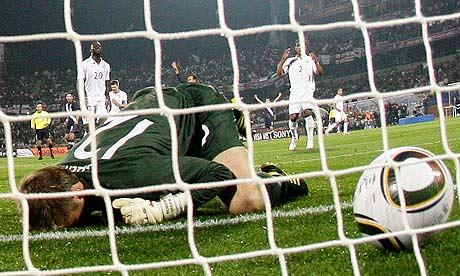 England's goalkeeper Robert Green concedes a howler against USA